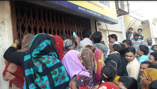 Police thrashing poor people outside the bank