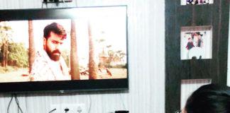 anchor anasuya watching rangastalam movie in television